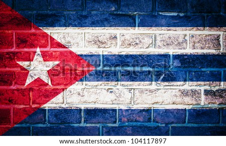 Collection of North America flag on old brick wall texture background, Cuba - stock photo