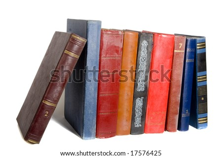 collection of old books on white ground - stock photo