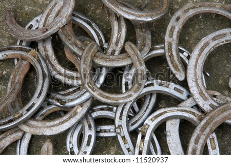 Collection of old horse shoes - stock photo
