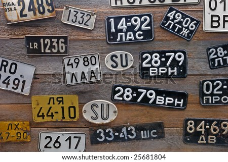 Collection of old Latvian automobile number-plates. - stock photo