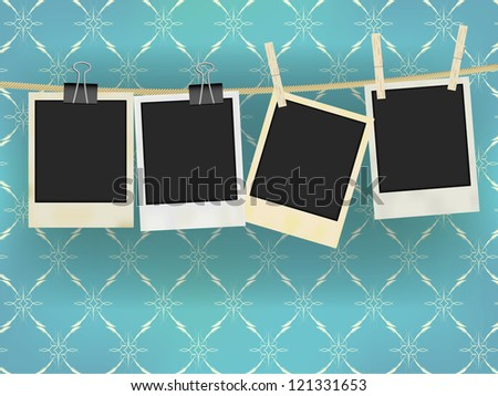 Collection of Old Retro Blank Photo Frames Hanging on Rope - on Vintage Wallpaper - stock photo