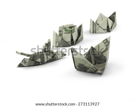 collection of origami ships of one hundred dollar banknotes - stock photo