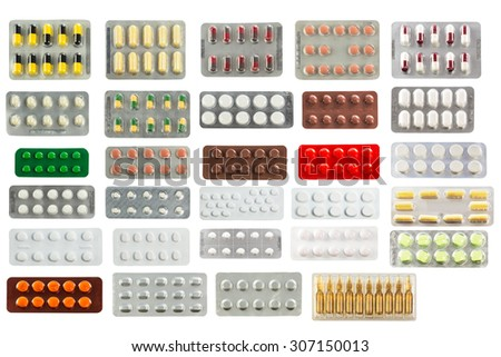collection of pills in transparent blister packs isolated on white background - stock photo