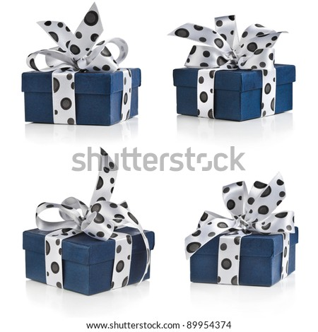 Collection of present box wrapped ribbon bow with black spots close up isolated on white background - stock photo