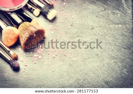 Collection of professional makeup brushes - stock photo
