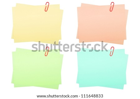collection of real note papers with paper clip on white background - stock photo