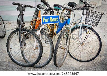 Collection of rental bicycles, chained together on display for tourists. - stock photo
