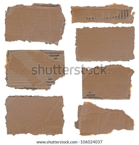 Collection of seven torn cardboard pieces isolated over white background - stock photo