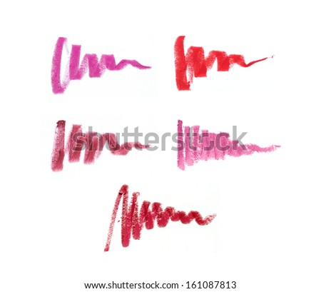 Collection of smudged lipsticks isolated on white - stock photo