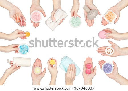 collection of spa and massage elements in a hands isolated on white background - stock photo