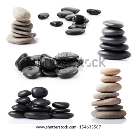 Collection of spa stones isolated on white background. Black massage stones stacked.  - stock photo