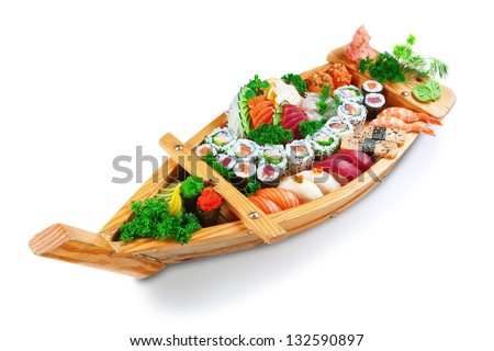 Collection of species sushi on the decorative plate ship. On a white background. - stock photo