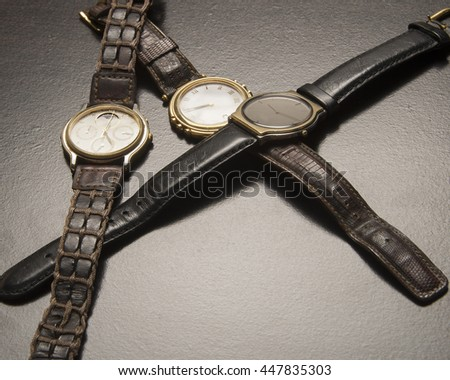 Collection of time pieces/Wrist Watches/Luxury chronometers with worn bands - stock photo