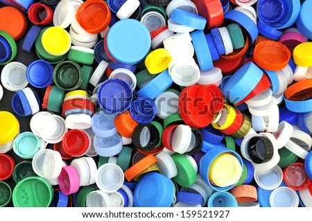 Collection of various colorful plastic screw caps. Usefull as background - stock photo