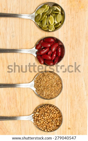 collection of various food ingredients in spoon - stock photo