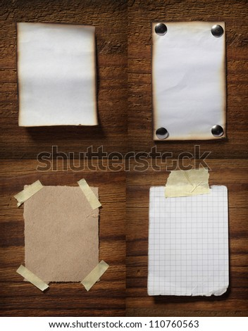 collection of various grunge note papers on wooden background - stock photo