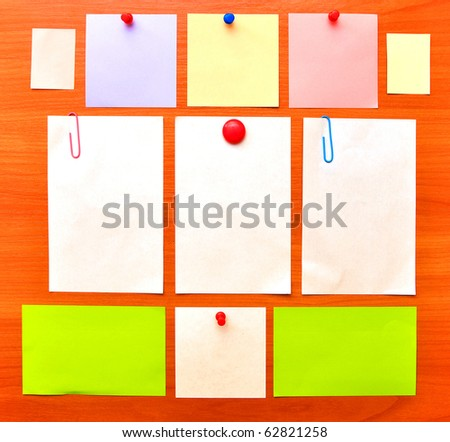 collection of various note papers on wood background - stock photo