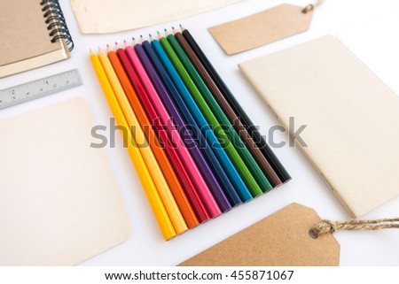 Collection of various paper, cardboard, tag, card, book and colour pencils with soft shadows. - stock photo