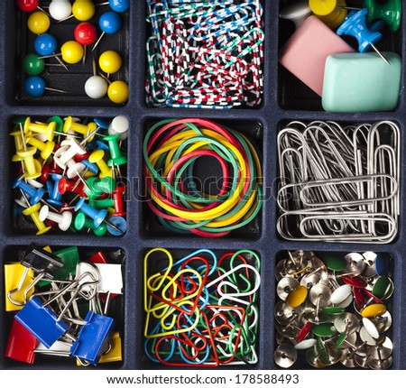collection of various stationery in black box surface top view - stock photo