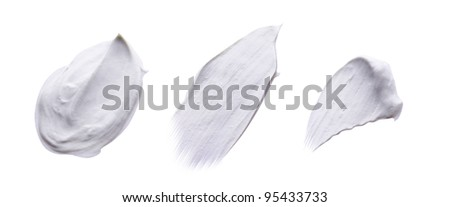 Collection of Various Strokes of White Beauty Cream Isolated on - stock photo