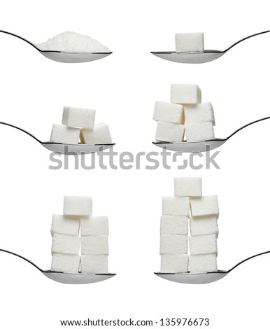 collection of various  sugar cubes in a spoon on white background. each one is shot separately - stock photo