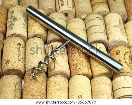 Collection of vine corks and vine screw - stock photo