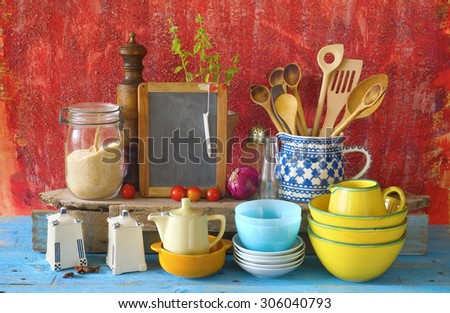 collection of vintage kitchenware, red old kitchen wall  background  - stock photo
