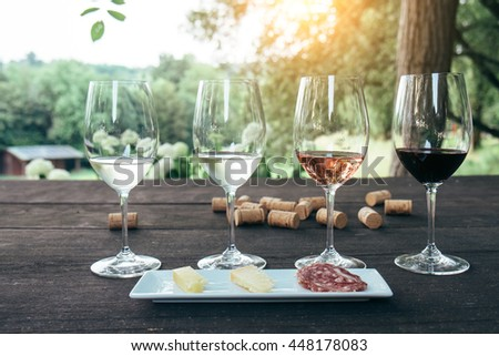 Collection of wine glasses on wooden table - stock photo