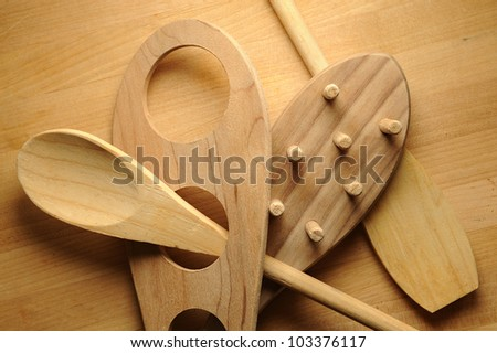 Collection of wooden kitchen utensils on wood background - stock photo