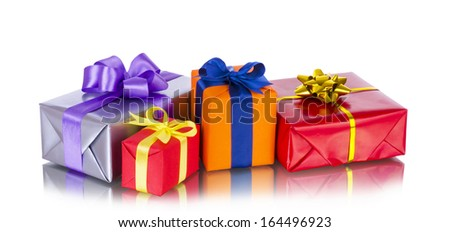 Collection row of colorful gift boxes with bows, isolated on  white  - stock photo