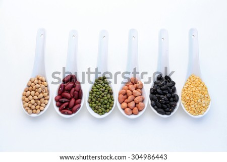 Collection set of beans, legumes, peas, lentils on ceramic spoons isolated on white background. - stock photo