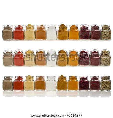 Collection set of long row powder colorful spices in glass jar isolated on white background - stock photo