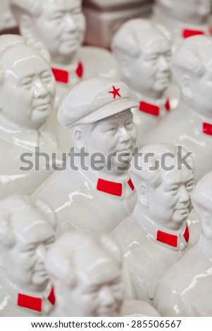 Collection white Mao Zedong sculptures on Panjiayuan Market, located in south east Beijing, China. - stock photo