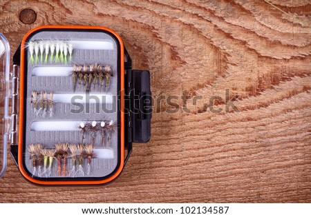 Collections of  flies in a tackle box for fly fishing - stock photo