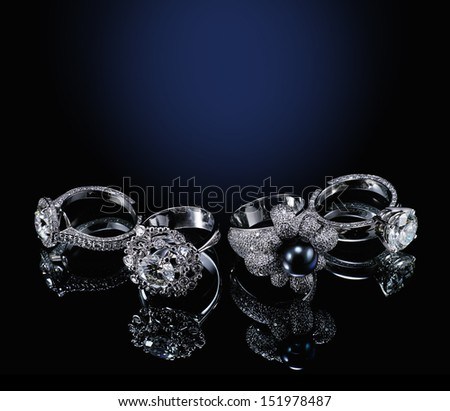 Collectionsof rings with diamond isolated on black background  - stock photo