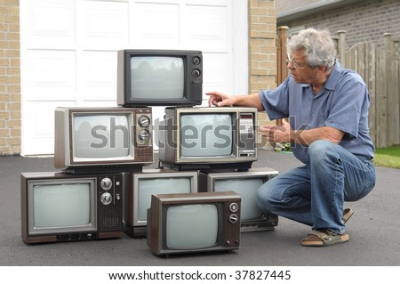 Collector of old TV sets - stock photo