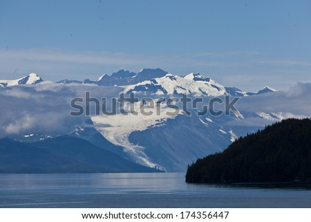 College Fjord mountains with cloud - stock photo