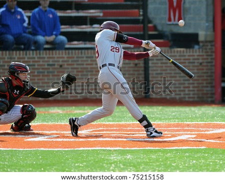 COLLEGE PARK, MD - APRIL 2: Florida State University catcher Rafael Lopez swings at a pitch and connects with it during a game against conference foe Maryland April 2, 2011 in College Park, MD. - stock photo