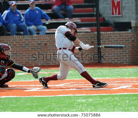 COLLEGE PARK, MD - APRIL 2: Florida State University outfielder James Ramsay swings at a pitch and fouls it off his ankle during a game against Maryland April 2, 2011 in College Park, MD. - stock photo
