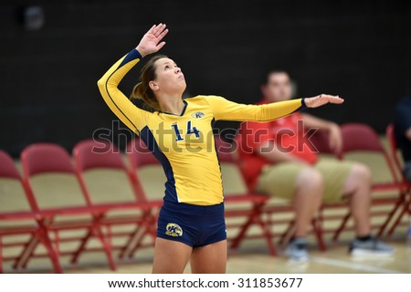 COLLEGE PARK, MD - AUGUST 28: Kent State setter Katarina Kojic (14) serves during the NCAA women's volleyball game August 28, 2015 in College Park, MD.  - stock photo