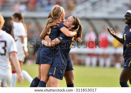 COLLEGE PARK, MD - AUGUST 28: West Virginia Kailey Utley (16) celebrates a first half goal during the NCAA women's soccer game August 28, 2015 in College Park, MD.  - stock photo