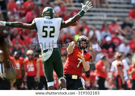 COLLEGE PARK, MD - SEPTEMBER 19: Maryland Terrapins quarterback Caleb Rowe (7) throws a pass during a NCAA football game September 19, 2015 in College Park, MD.  - stock photo