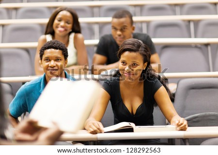 college professor lecturing group of african students in classroom - stock photo