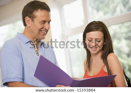 College professor providing guidance to a female student - stock photo