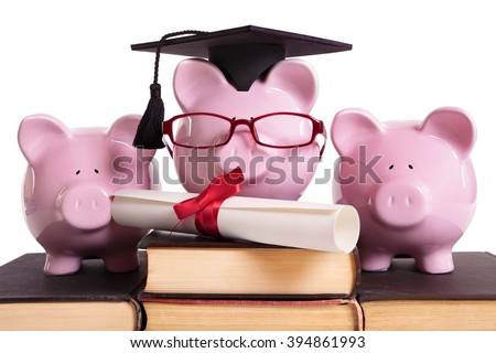 College student graduate graduation concept, piggybank wearing glasses - stock photo