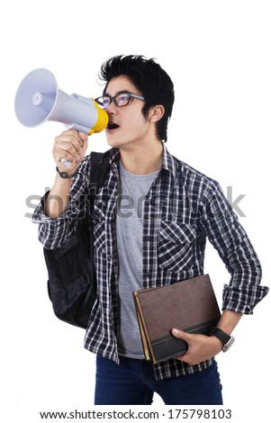 College student shouting through megaphone isolated on white background - stock photo