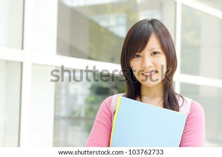 College Student standing outside college building - stock photo
