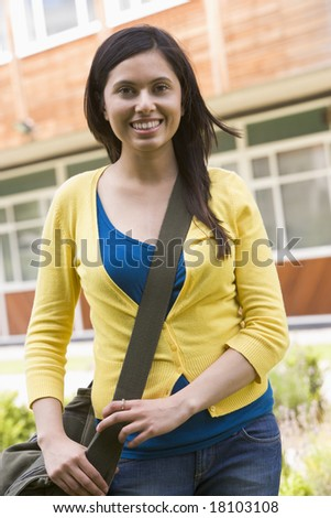 college student stood outside - stock photo