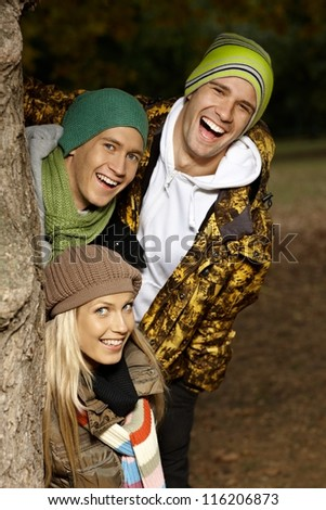 College students having fun in autumn park, smiling. - stock photo