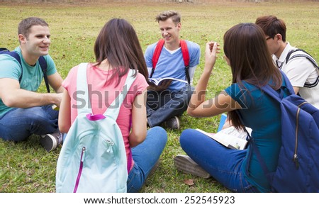 College students studying and discuss together in campus  - stock photo